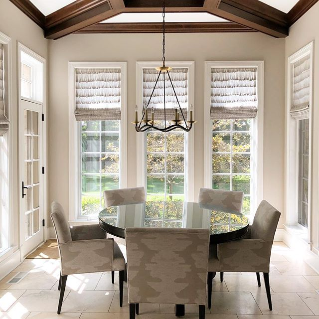 Minimal and classic dining room with reflective round table. Beautiful interior design inspiration from Chicago designer Cari Giannoulias on Hello Lovely Studio. #hellolovelystudio #interiordesign #carigiannoulias #chicagodesigner #interiordesigner #sophisticateddecor #understated #luxurydecor