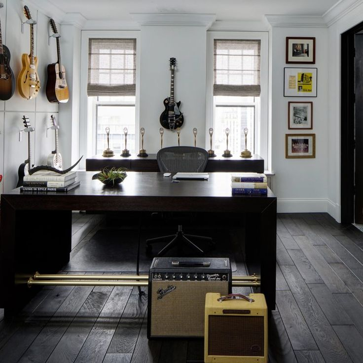 Stylish home office with guitars on wall. Beautiful interior design inspiration from Chicago designer Cari Giannoulias on Hello Lovely Studio. #hellolovelystudio #interiordesign #carigiannoulias #chicagodesigner #interiordesigner #sophisticateddecor #understated #luxurydecor