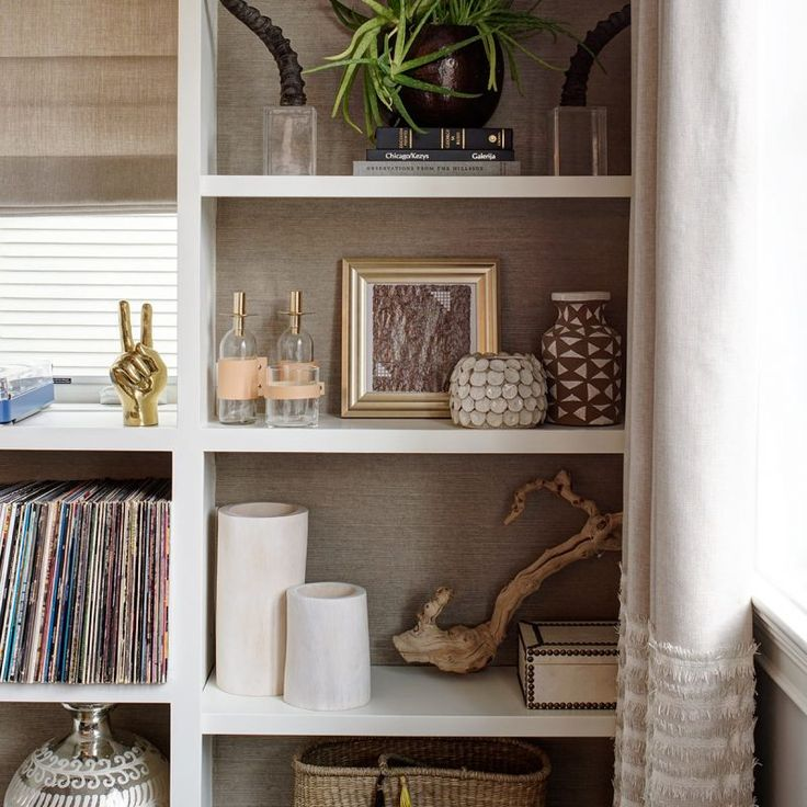 Built-in shelves with grasscloth wallcovering. Check out: Cari Giannoulias: Layered, Livable, Lovely Luxe! Beautiful interior design inspiration from Chicago designer Cari Giannoulias on Hello Lovely Studio. #hellolovelystudio #interiordesign #carigiannoulias #chicagodesigner #interiordesigner #sophisticateddecor #understated #luxurydecor