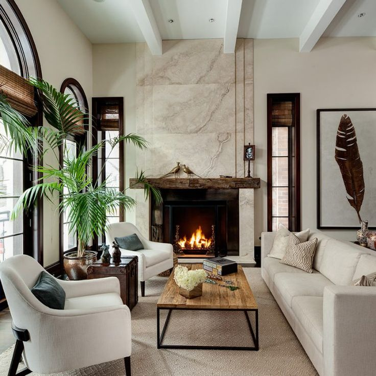 Living room with tropical exotic accents and ivory by Cari Giannoulias.