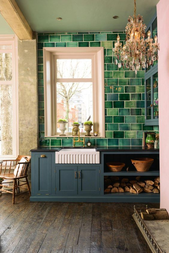 Gorgeous blue kitchen with English country charm by deVOL kitchens. Amazing green glazed handmade tile backsplash. Clerkenwell blue painted cabinetry.