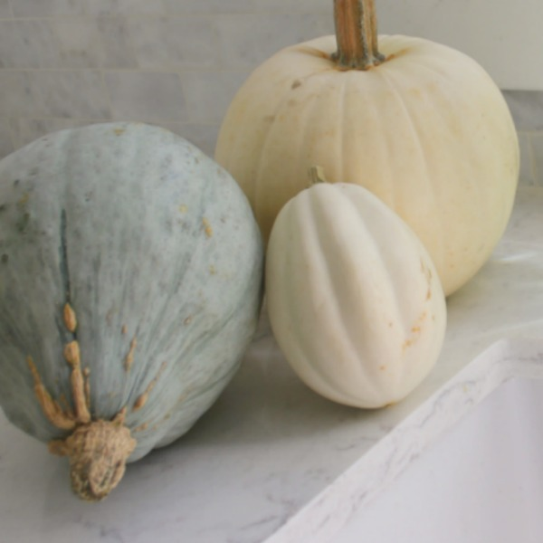 Pastel and white fall decor in my kitchen which has a relaxed, European country and shabby chic vibe. See more of it on my blog Hello Lovely where you'll see my style is serene and peaceful. #hellolovelystudio #falldecor #pastels #serenedecor #whitedecor #europeancountry #farmhousestyle #frenchfarmhouse #pumpkins