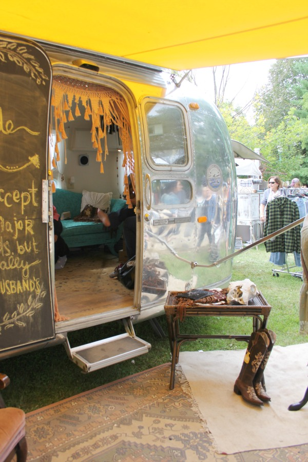 Vintage airstream with bright yellow awning at Main Street Market - Hello Lovely Studio.
