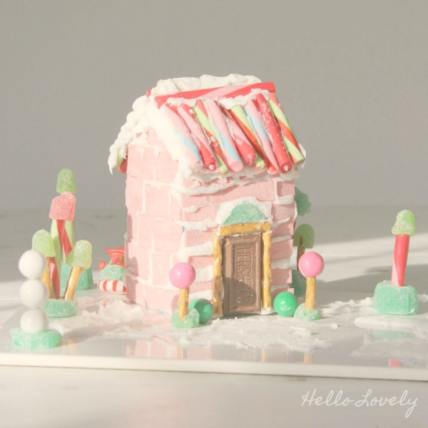 Candy house with pink chewing gum sticks. #hellolovelystudio #gingerbreadhouse #christmasdecor #pinkchristmas