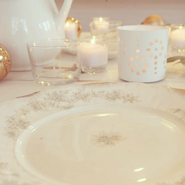 Romantic and serene white farmhouse tablescape with shabby chic vintage style and European inspired charm. Blush roses, white ironstone, candlelight, and fresh greenery are a few of the ingredients. Hello Lovely Studio. #hellolovelystudio #tablescape #whitedecor #frenchfarmhouse #tabledecor #shabbychic #romanticdecor #frenchcountry #placesetting