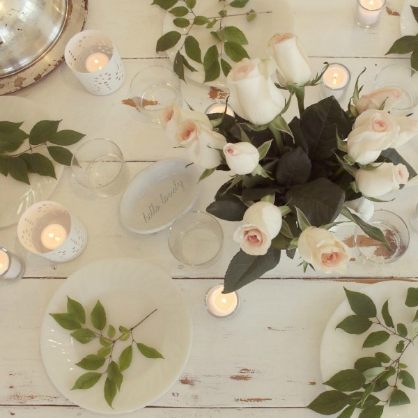 White romantictablescape with candlelight and blush roses. Hello Lovely Studio.