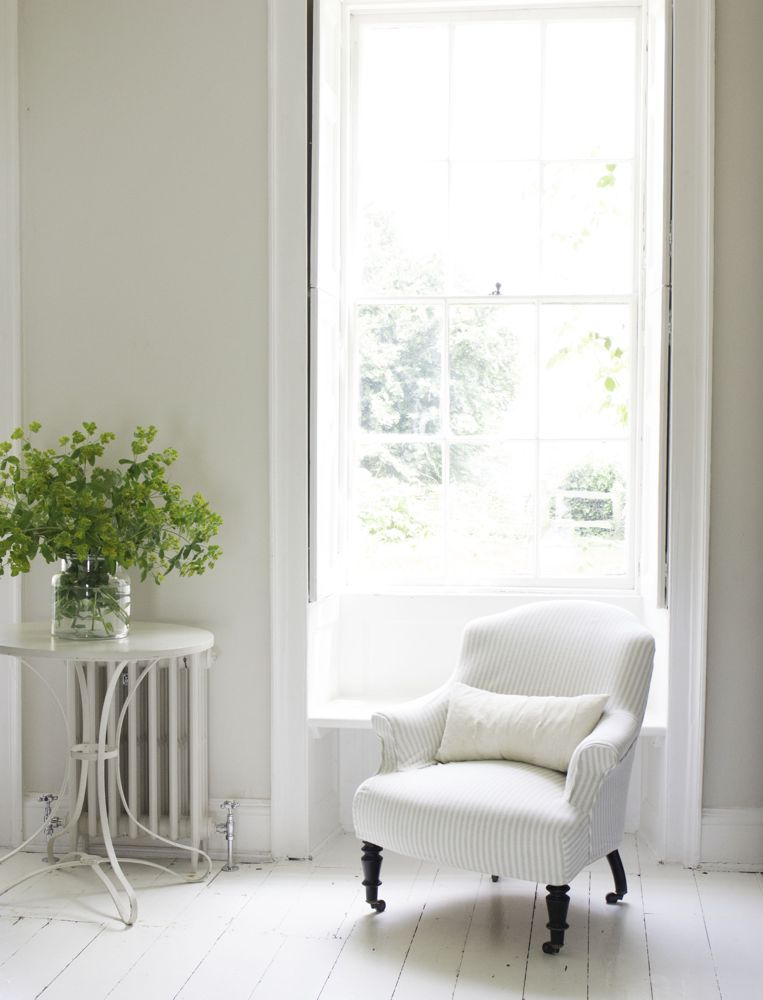 "Multiple shades of white mix for a glorious cloud-like interior. Scandinavian style white Nordic French design details as well as spare decor style meet English countryside charm in ""The Hatch,"" a photographic location in Wiltshire. Design: Atlanta Bartlett & Dave Coote of the Beach Studios. #livingroom #scandinavian #interiordesign #whitedecor #frenchnordic #nordicFrench #Swedishstyle #serene #shabbychic"
