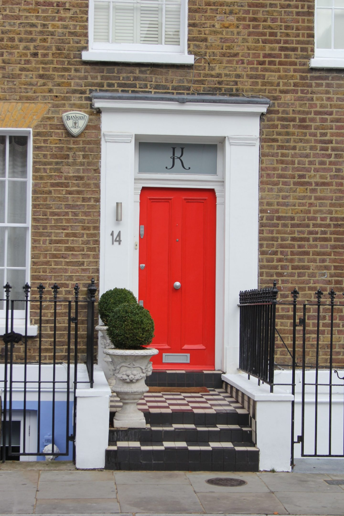 Shocking red orange on a front door! Hello Lovely Studio. Come tour these gorgeous front doors in Notting Hill and Holland Park...certainly lovely indeed. Curb appeal and Paint Color Inspiration. Lovely London Doors & Paint Color Ideas!