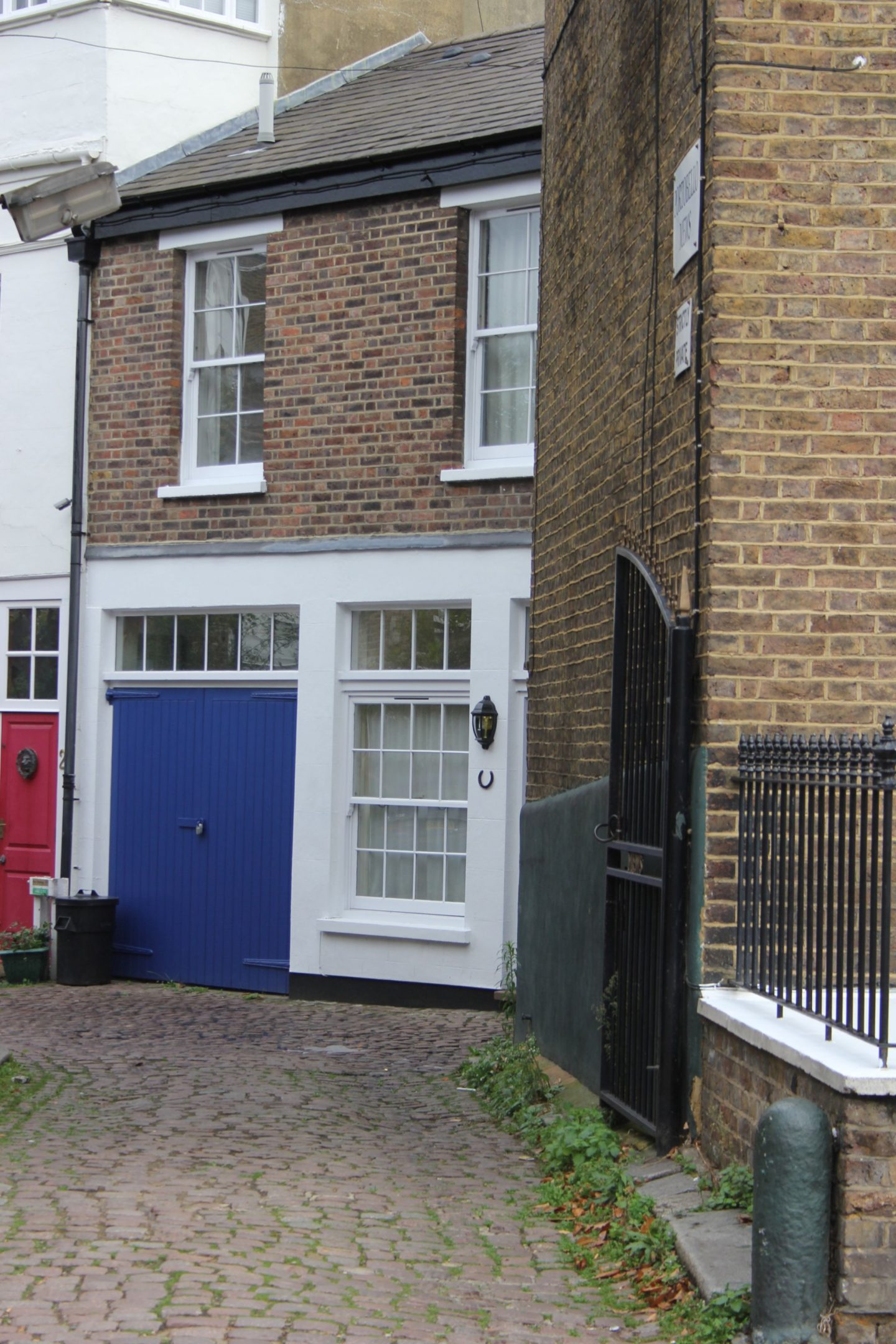 Bright electric blue painted stable doors to entrance of mews. Hello Lovely Studio. Come tour these gorgeous front doors in Notting Hill and Holland Park...certainly lovely indeed. Curb appeal and Paint Color Inspiration. Lovely London Doors & Paint Color Ideas!