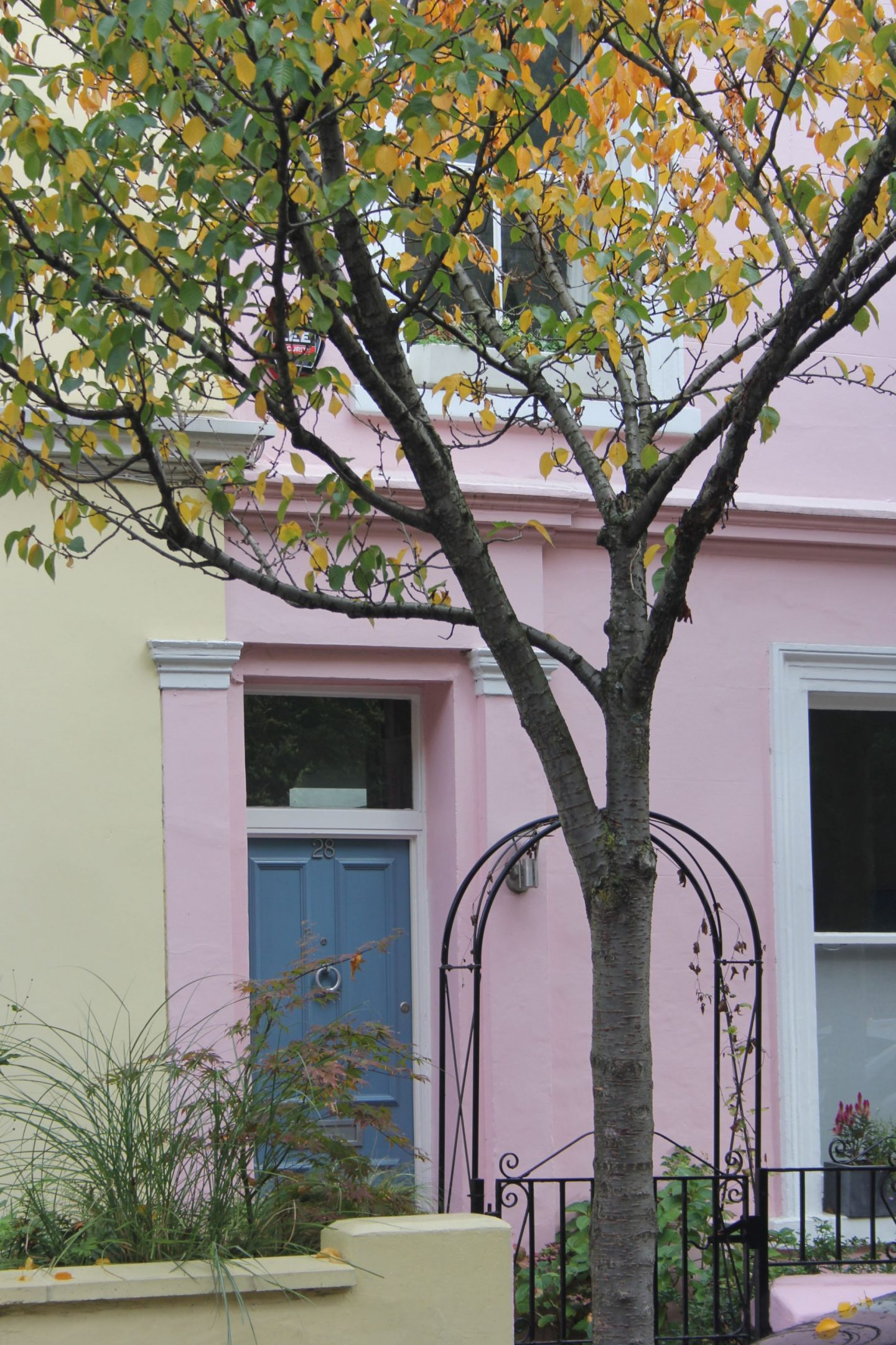 French blue paint on a front door of a pastel row house. Hello Lovely Studio. Come tour these gorgeous front doors in Notting Hill and Holland Park...certainly lovely indeed. Curb appeal and Paint Color Inspiration. Lovely London Doors & Paint Color Ideas!
