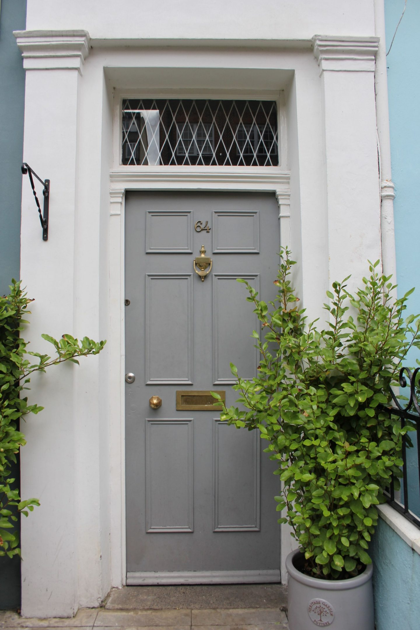 Grey painted front door in London. Hello Lovely Studio. Come tour these gorgeous front doors in Notting Hill and Holland Park...certainly lovely indeed. Curb appeal and Paint Color Inspiration. Lovely London Doors & Paint Color Ideas!