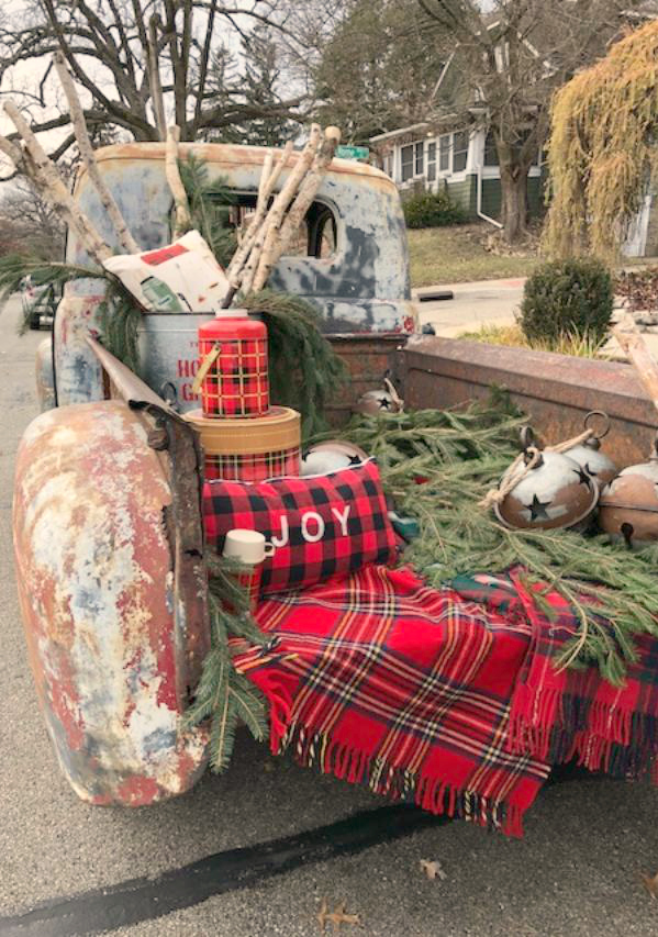 Vintage truck filled with farmhouse Christmas decor at Urban Farmgirl in Rockford, IL. Hello Lovely Studio.