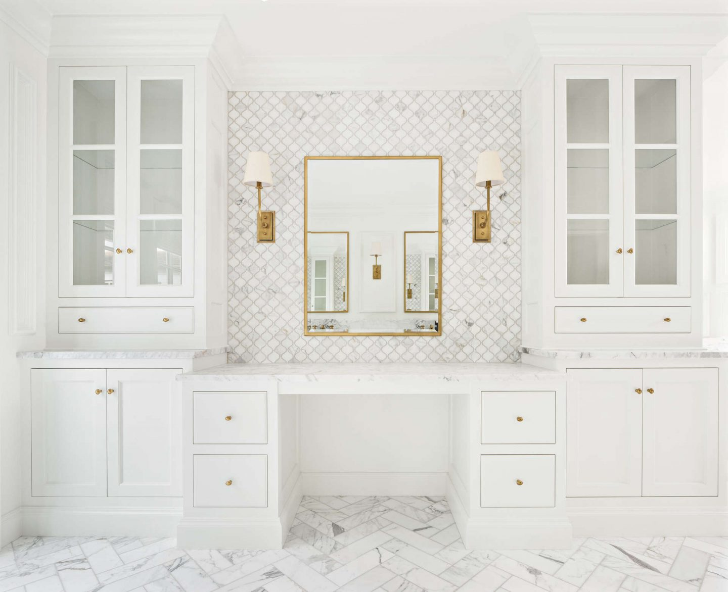 White calacatta marble luxurious bathroom design by The Fox Group with makeup area. Come explore these timeless design ideas...hello lovely indeed. #thefoxgroup #luxuriousbathroom #calacattamarble #whitebathrooms #bathroomdesign
