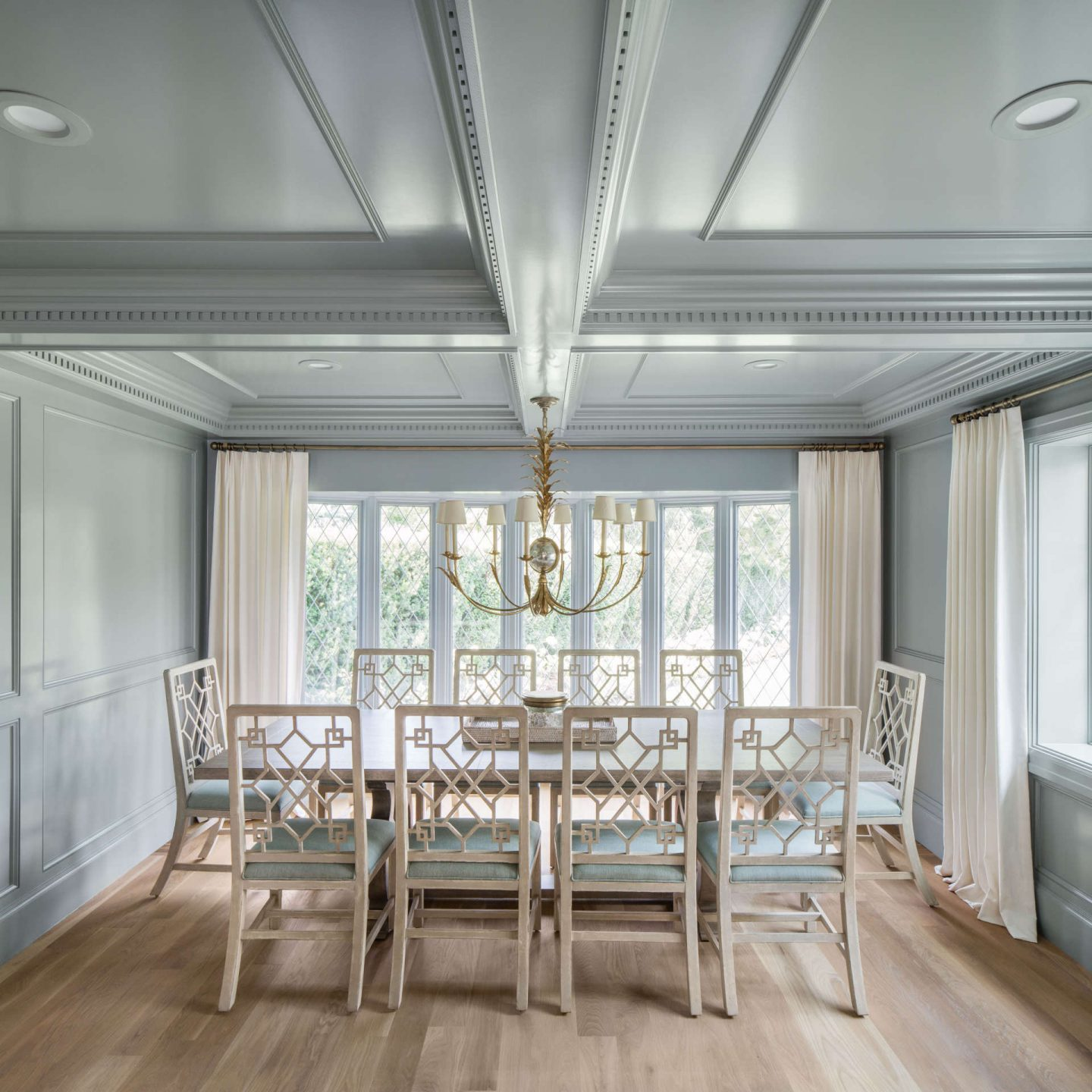 Magnificent paneling on walls and ceiling of a dining room by the Fox Group in a renovated Tudor home. #diningroom #thefoxgroup #millwork #traditional