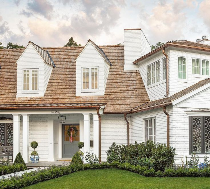 White painted brick house exterior and classic Tudor style from the Fox Group. Come explore these timeless design ideas...hello lovely indeed. #houseexterior #tudor #thefoxgroup