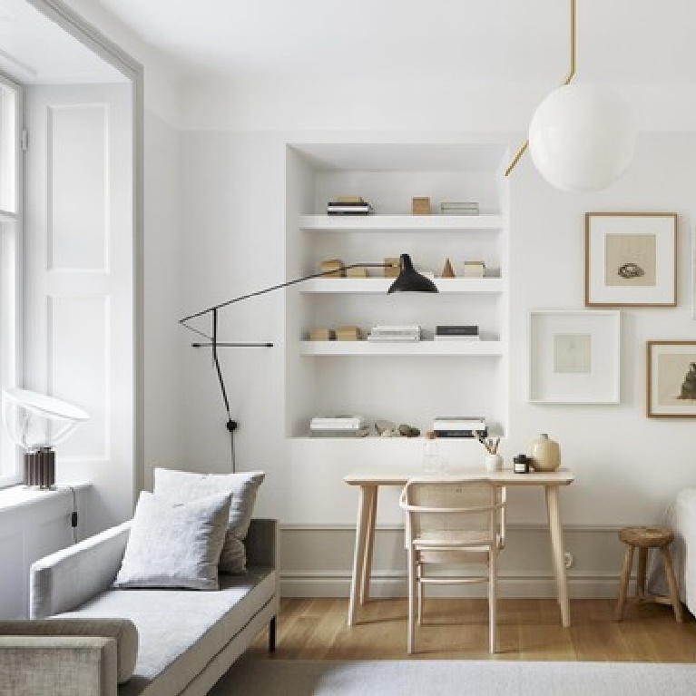 Lovely serene Stockholm apartment bedroom with muted quiet colors of light grey and white and modern Scandi design - Frantastic Frank. #scandinavian #interiordesign #stockholmapartmet #bedroomdesign #bedroomdecor
