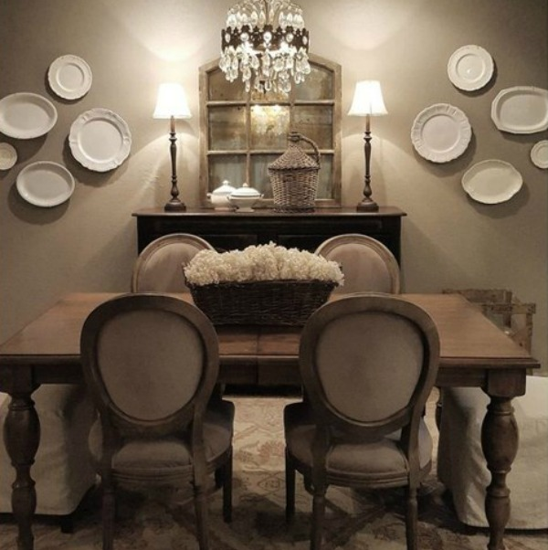 Stunning Country French farmhouse dining room with white plates displayed decoratively on the wall. Design by The French Nest Interior Design Co.