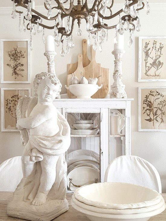 Enchanting Country French farmhouse dining room in white by the French Nest Interior Design Co.