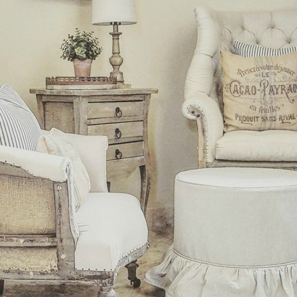 Gorgeous white French country living room by The French Nest. #frenchfarmhouse #frenchcountry #livingroom #armchairs