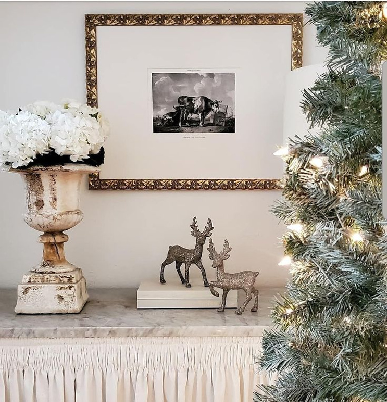 Holiday decor with a French country theme, Christmas tree, and old urn - The French Nest Interior Design Co. #holidaydecor #christmasdecorating #frenchcountry