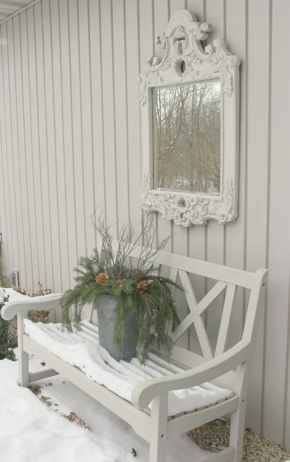 Simple Christmas decor outside in the French inspired courtyard. Hello Lovely Studio.