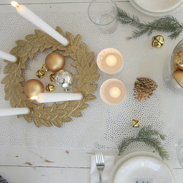 Gold advent wreath and rustic farmhouse tablescape by Hello Lovely Studio.