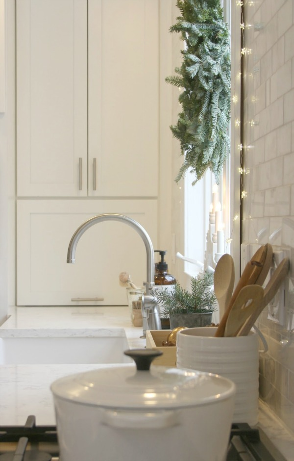 My white kitchen decorated simply with white and green for Christmas. Hello Lovely Studio.