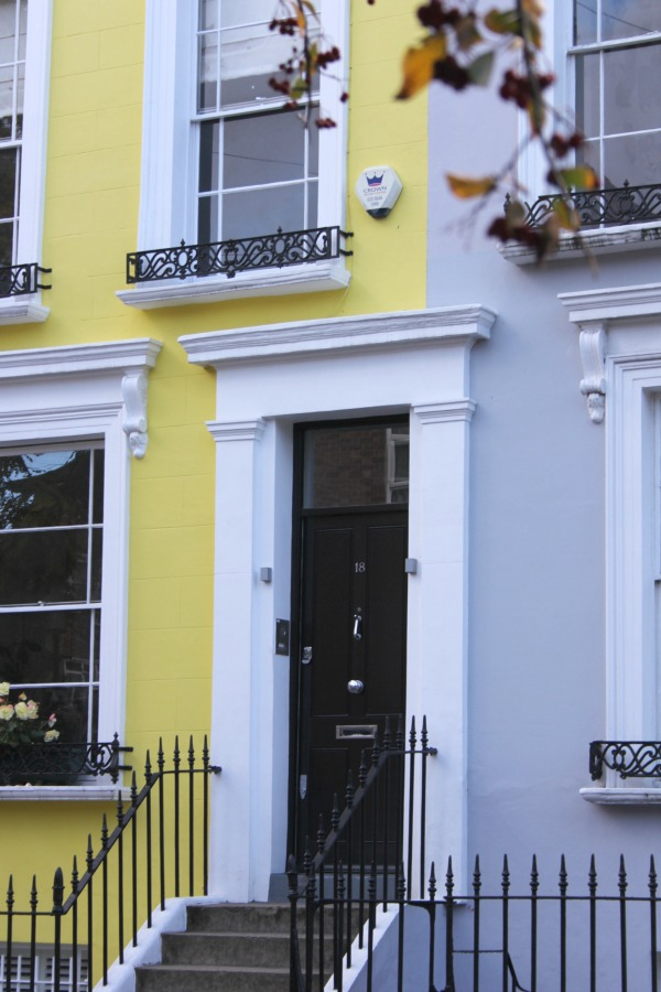 Bright yellow stucco townhouse in London. Hello Lovely Studio. Come tour these gorgeous front doors in Notting Hill and Holland Park...certainly lovely indeed. Curb appeal and Paint Color Inspiration. Lovely London Doors & Paint Color Ideas!
