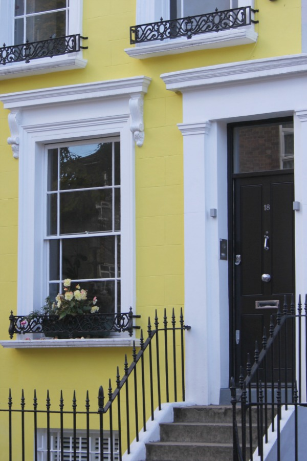 Bright yellow townhouse exterior in London. Hello Lovely Studio. Come tour these gorgeous front doors in Notting Hill and Holland Park...certainly lovely indeed. Curb appeal and Paint Color Inspiration. Lovely London Doors & Paint Color Ideas!