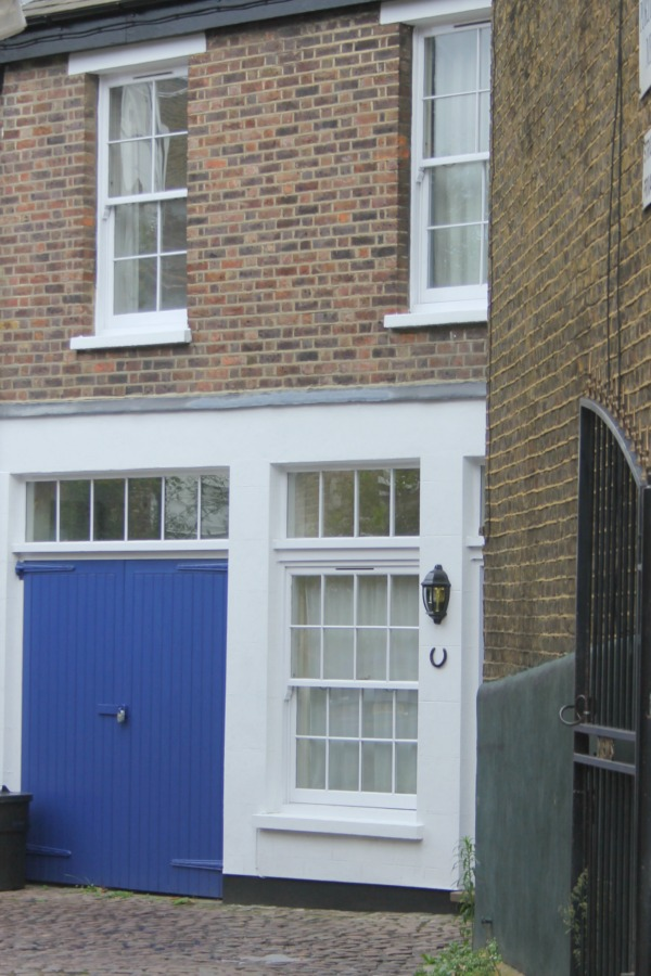 Bright blue doors on home converted from stable. Hello Lovely Studio. Come tour these gorgeous front doors in Notting Hill and Holland Park...certainly lovely indeed. Curb appeal and Paint Color Inspiration. Lovely London Doors & Paint Color Ideas!