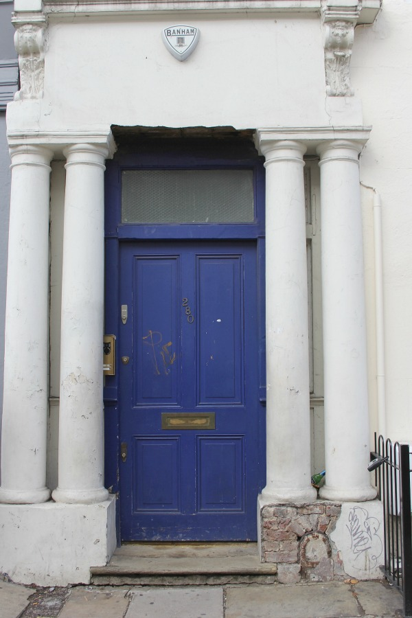 Blue door to the famed Notting Hill movie apartment flat of Hugh Grant's character. 280 Westbourne in Notting Hill. Photo by Hello Lovely Studio.