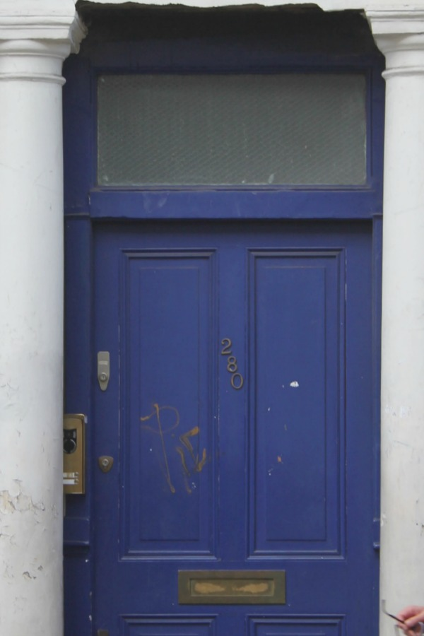 "Detail of blue door to Notting HIll flat of Hugh Grant's character in the film ""Notting Hill."" Photo by Hello Lovely Studio."