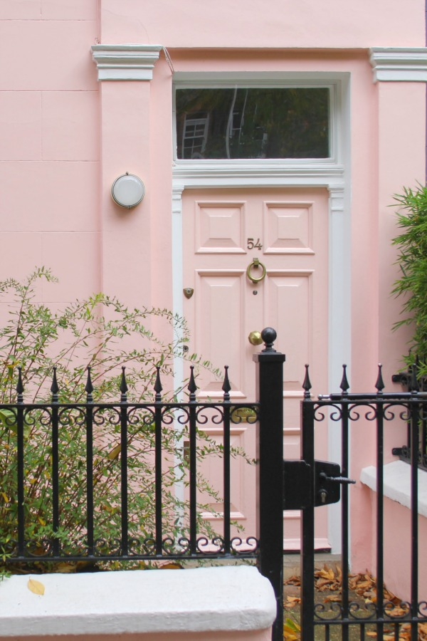 Light pink door on pink stucco row house in London. Hello Lovely Studio. Come tour these gorgeous front doors in Notting Hill and Holland Park...certainly lovely indeed. Curb appeal and Paint Color Inspiration. Lovely London Doors & Paint Color Ideas!