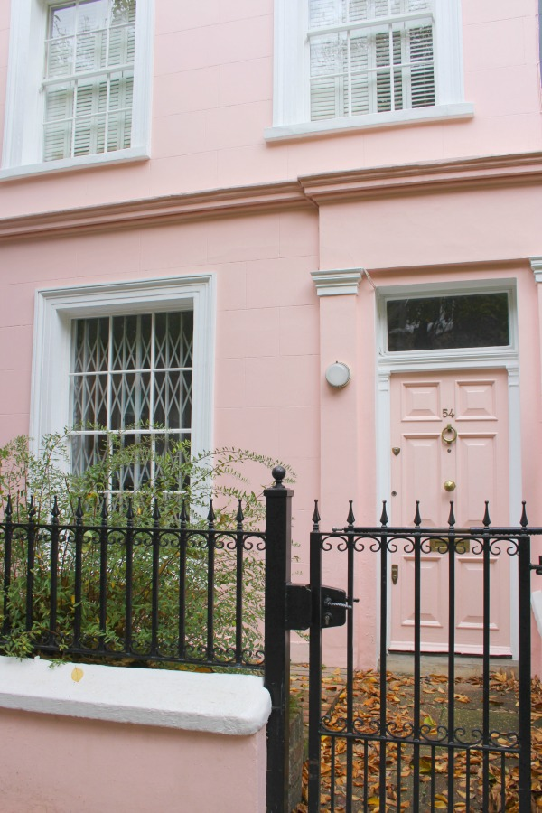 Pink door on pink stucco home. Hello Lovely Studio. Come tour these gorgeous front doors in Notting Hill and Holland Park...certainly lovely indeed. Curb appeal and Paint Color Inspiration. Lovely London Doors & Paint Color Ideas!
