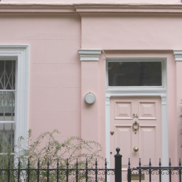 Pink townhouse in Notting Hill with pink door and gorgeous details.