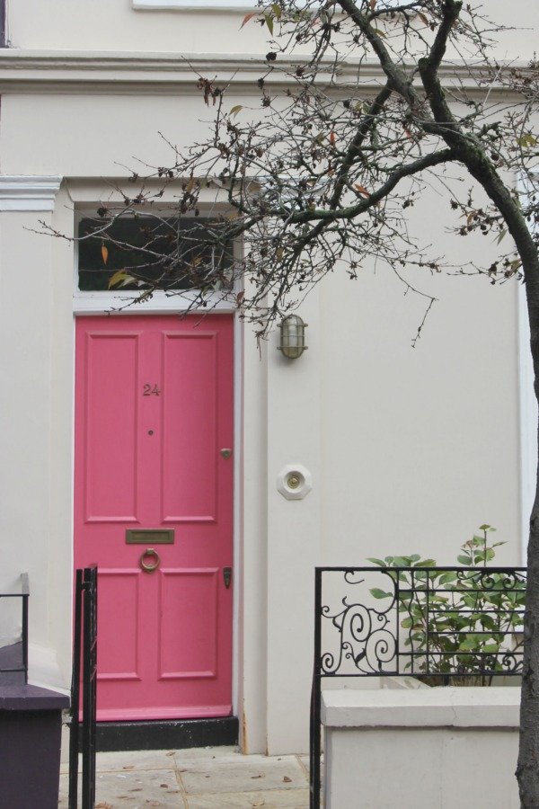 Gorgeous rosy pink painted front door on row house. Hello Lovely Studio. Come tour these gorgeous front doors in Notting Hill and Holland Park...certainly lovely indeed. Curb appeal and Paint Color Inspiration. Lovely London Doors & Paint Color Ideas!
