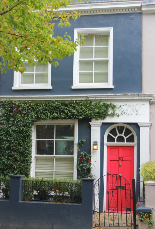 Medium denim blue painted stucco facade with bright red orange front door. Hello Lovely Studio. Come tour these gorgeous front doors in Notting Hill and Holland Park...certainly lovely indeed. Curb appeal and Paint Color Inspiration. Lovely London Doors & Paint Color Ideas!
