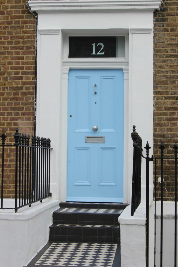 Bright baby blue door on elegant brick row house. Hello Lovely Studio. Come tour these gorgeous front doors in Notting Hill and Holland Park...certainly lovely indeed. Curb appeal and Paint Color Inspiration. Lovely London Doors & Paint Color Ideas!