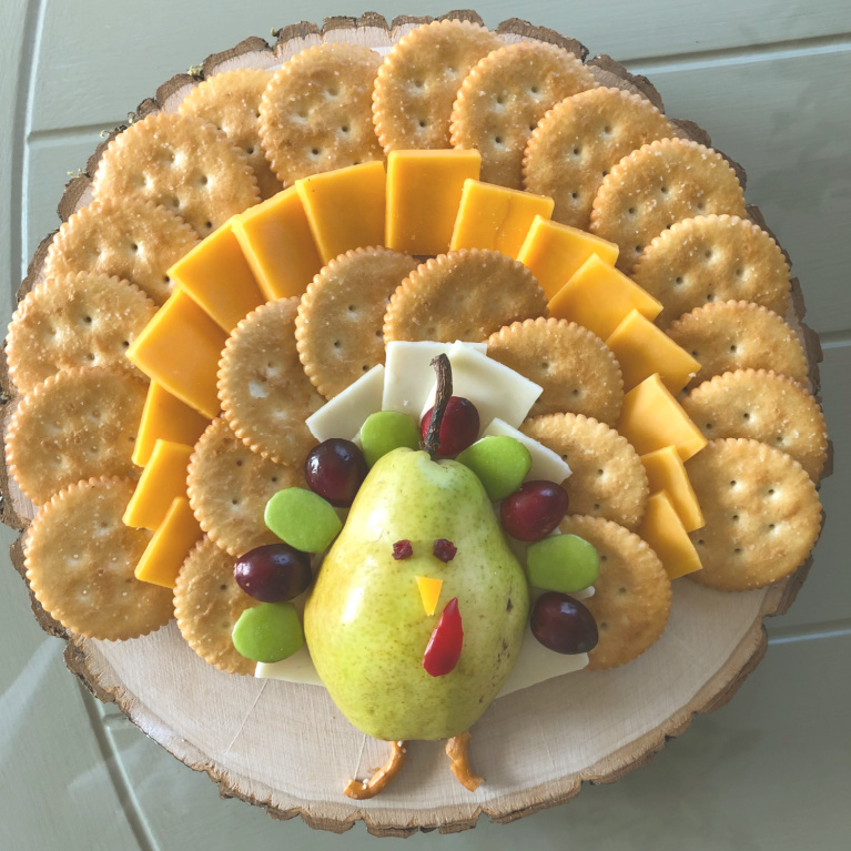 This cheese platter with pear shaped turkey was inspired by the one I saw on Itsalwaysautumn, and mine is a smaller simpler version - Hello Lovely Studio. #thanksgivingrecipes #cheeseboard #cuteappetizer #appetizerideas