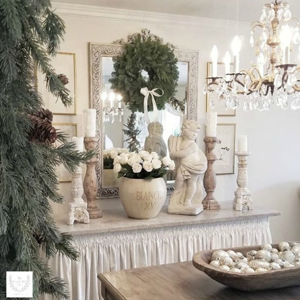 French Country dining room decorated for Christmas. in pale tones and sophisticated Old World style. Beautiful holiday decor inspiration from interior designers and bloggers. Come discover 28 Amazing Christmas Decorating Ideas! #christmasdecor #holidaydecorating
