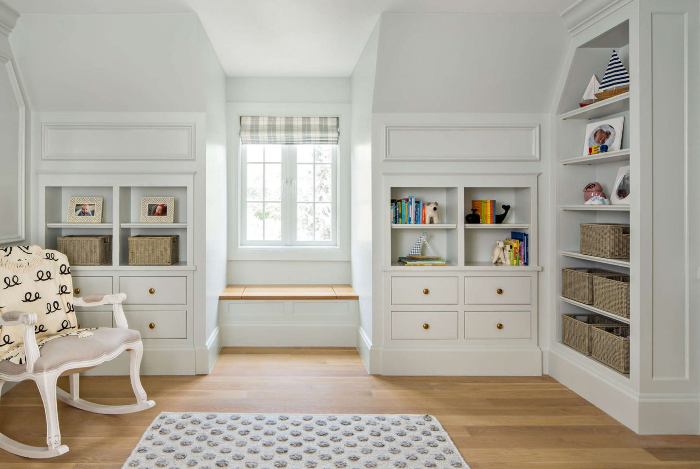Built in cabinetry in a traditional style nursery. #thefoxgroup #nursery #traditional #builtins