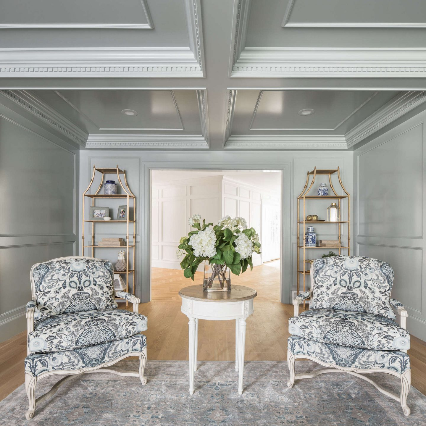Bergere chairs in a paneled traditional style living area by the Fox Group. Come explore these timeless design ideas...hello lovely indeed. #interiordesign #thefoxgroup #millwork