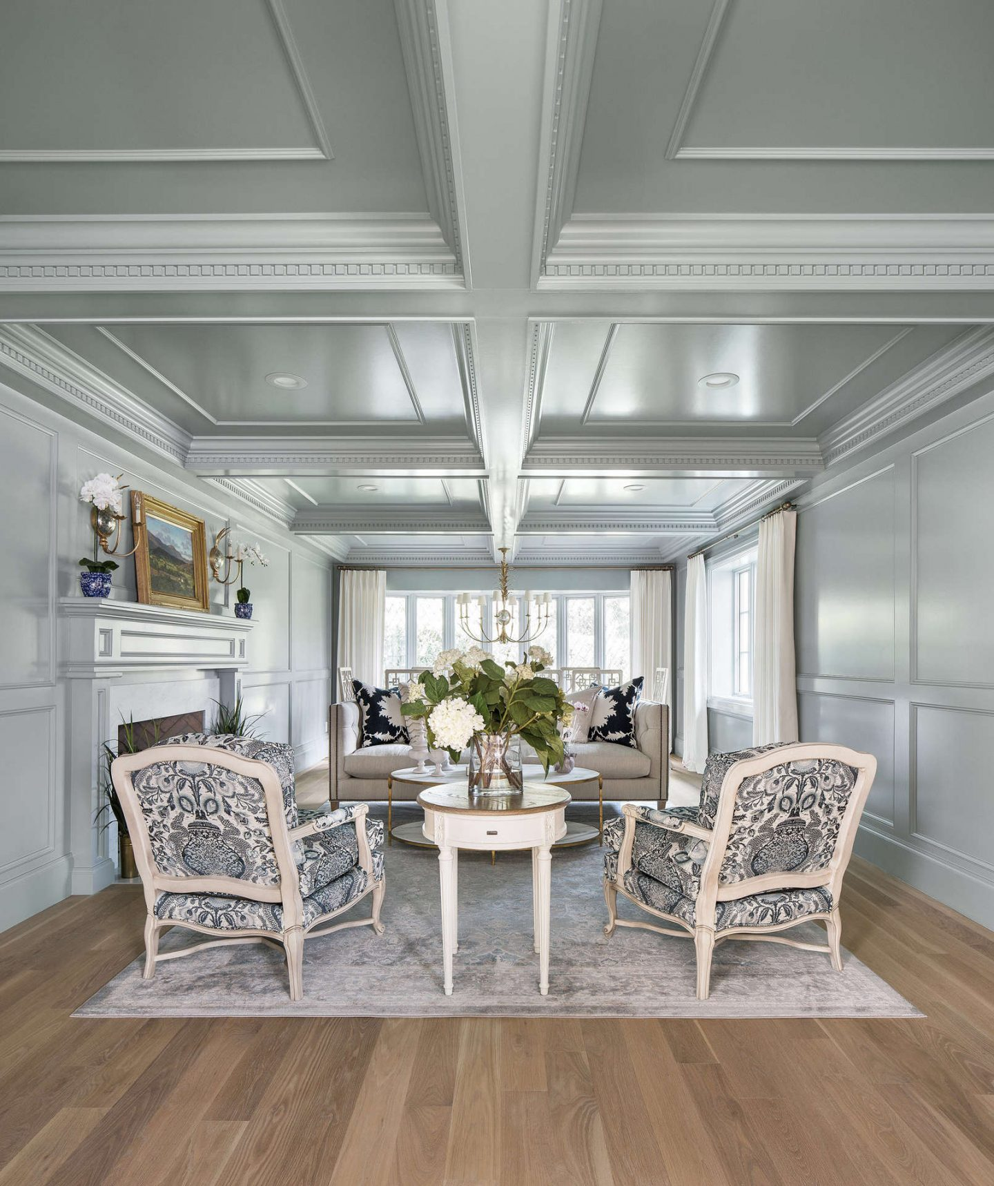 Serene and ethereal aqua blue gray painted paneled walls and coffered ceiling in a traditional living room in a Tudor home. Come explore these timeless design ideas...hello lovely indeed. #thefoxgroup #livingroom #interiordesign