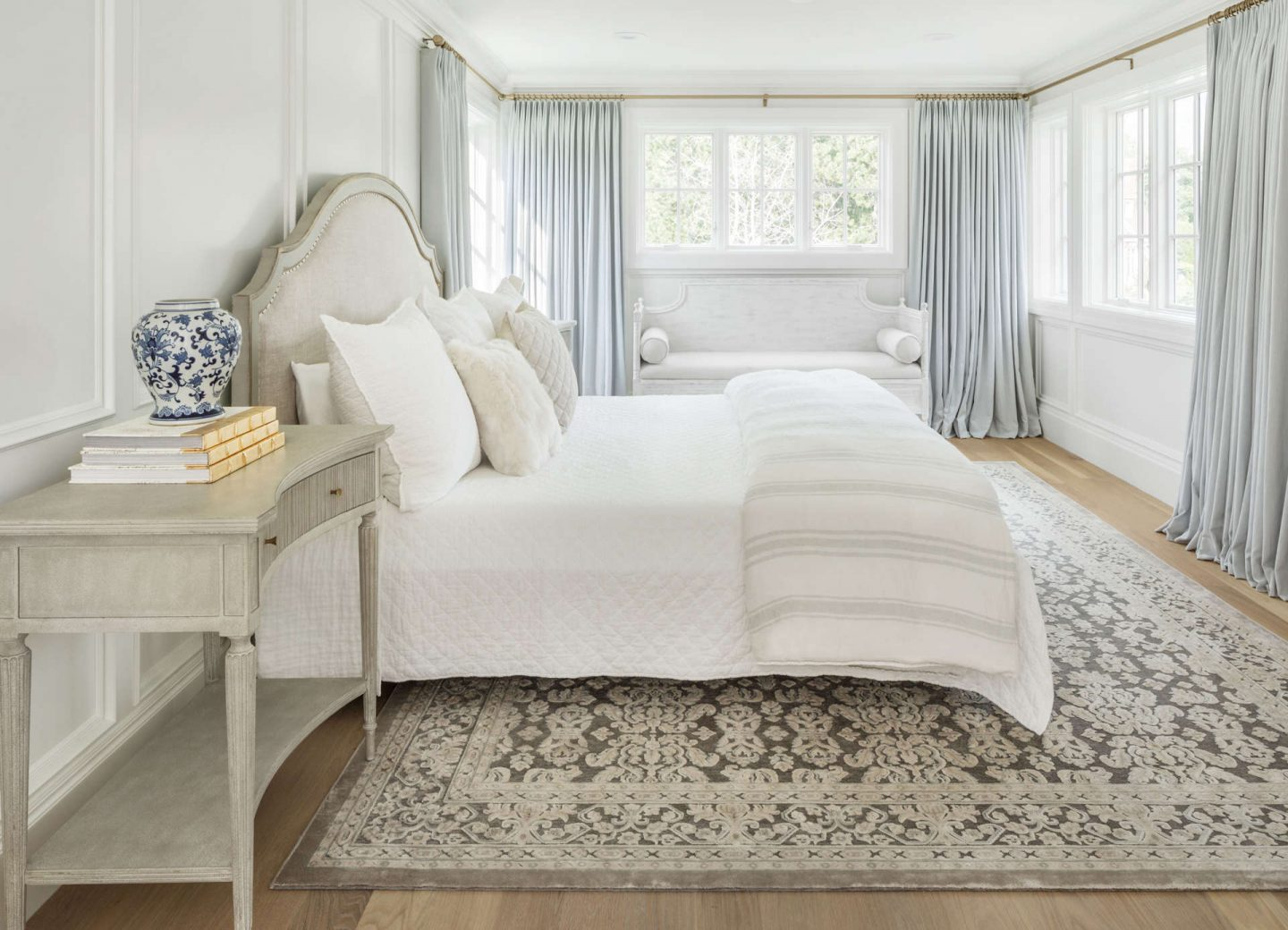 Gorgeous serene bedroom with quiet colors and beautiful paneled walls. #thefoxgroup #bedroom #interiordesign