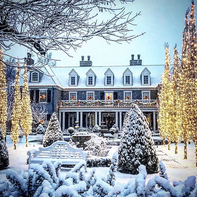 Snow covered grand traditional house exterior with gabled dormers. This example of classic traditional architecture from The Fox Group will inspire your design plans! Come see more lovely interior design and home construction ideas. #architecture #interiordesign #traditional #classic #thefoxgroup