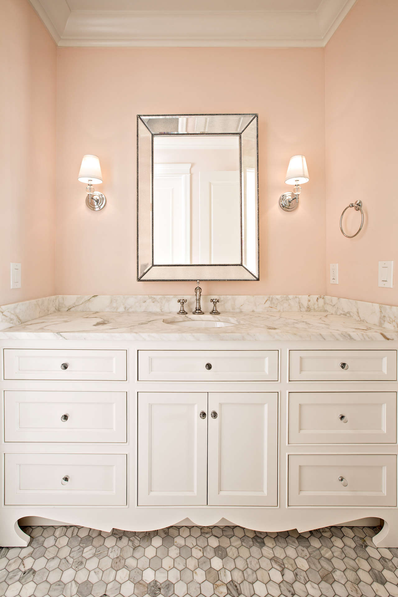 Blush pink walls in a beautiful powder room by The Fox Group.