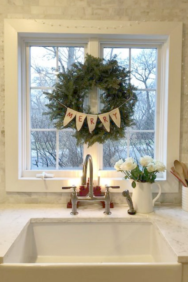 Fresh Christmas wreath over farm sink - Hello Lovely Studio.