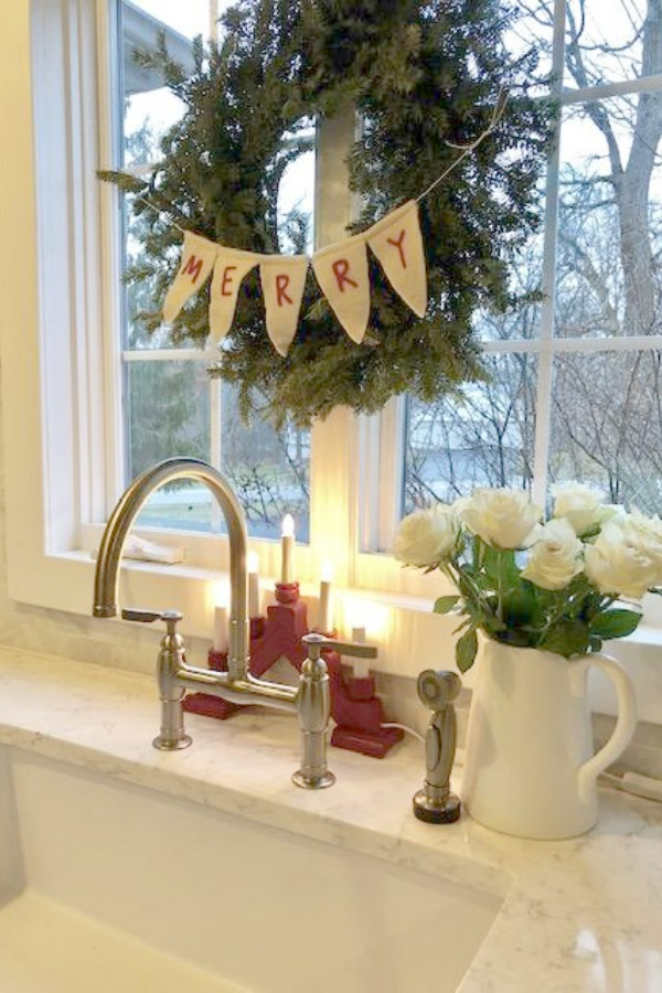 Farm sink, Swedish candelabra, and white roses - Hello Lovely Studio - Christmas 2018.
