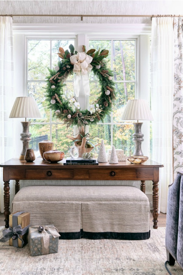 Elegant Christmas wreath and decor in a vignette at a showhouse in Atlanta. Beautiful holiday decor inspiration from interior designers and bloggers. Come discover 28 Amazing Christmas Decorating Ideas! #christmasdecor #holidaydecorating
