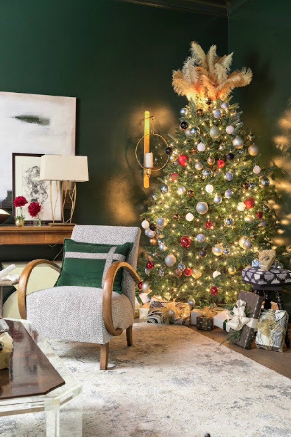 Christmas tree topped with feathers and adorned with colorful modern pops of color and sophistication in an Atlanta home for the holidays showhouse. Beautiful holiday decor inspiration from interior designers and bloggers. Come discover 28 Amazing Christmas Decorating Ideas! #christmasdecor #holidaydecorating